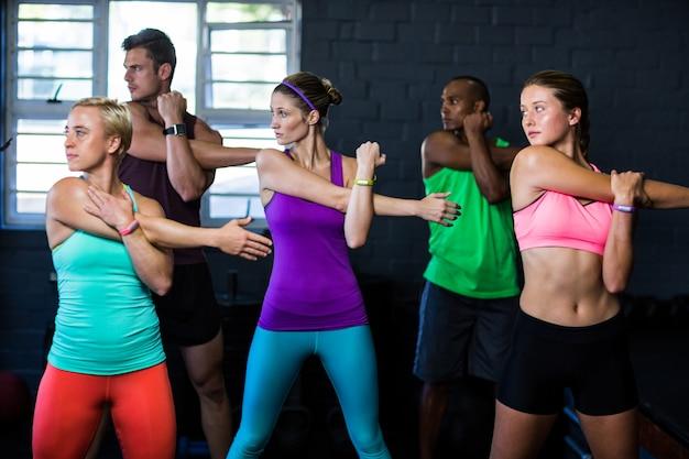 Athletes exercising in fitness studio