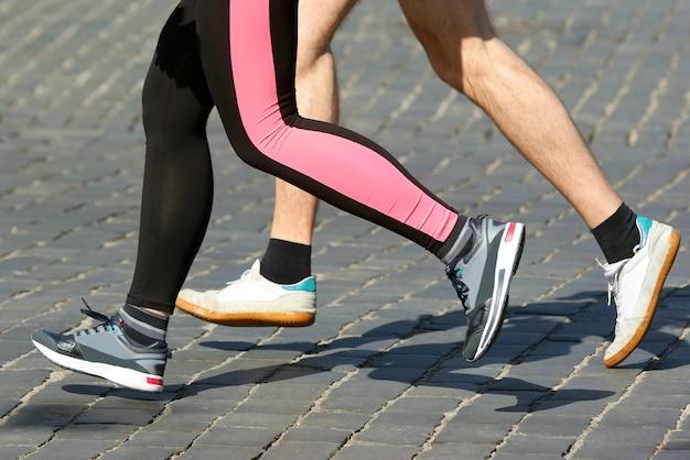 Athletes run marathons on the pavement. sport and health