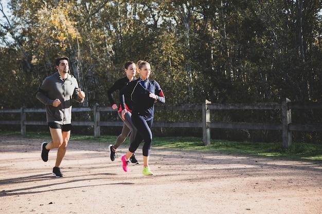 Athletes running outdoors