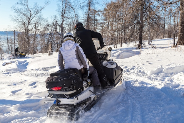 Athletes on a snowmobile.