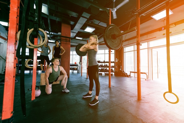 Athletes training in a cross-fit gym