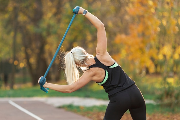 Athletic blonde woman doing fitness exercises