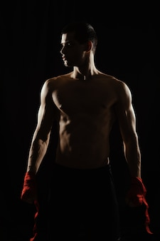 Athletic boxer getting ready before the fight