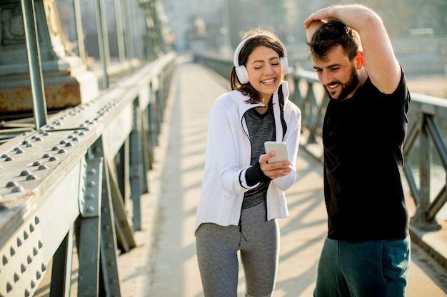 Athletic couple is having a rest after jogging in the city
