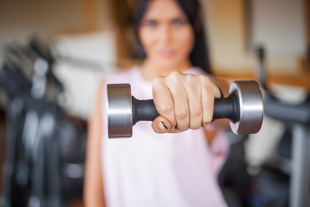 Athletic fitness young woman doing sports exercises