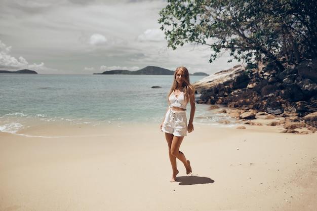 Athletic girl fun on the beach