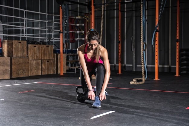 Athletic girl ready to start exercises at the gym