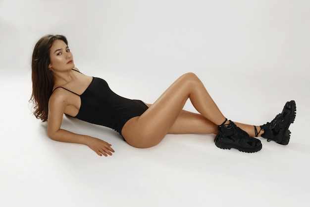 Athletic and healthy girl posing in black bodysuit.