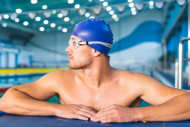 Athletic male swimmer looking away