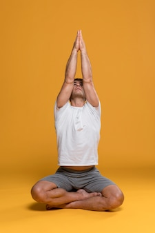 Athletic man doing yoga pose