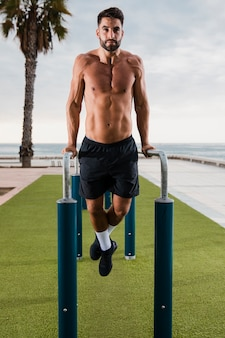 Athletic man exercising outdoor by seaside