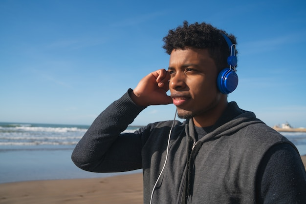 Athletic man listening to music