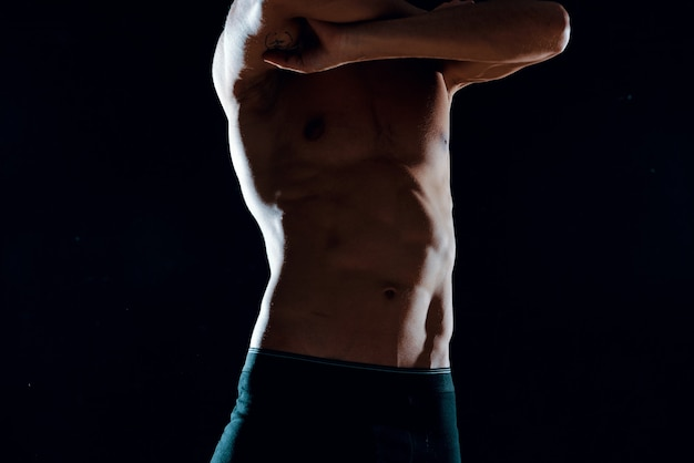 アスリートの男性の筋肉の腹筋は、ビューモチベーション運動フィットネスをトリミングしました。高品質の写真