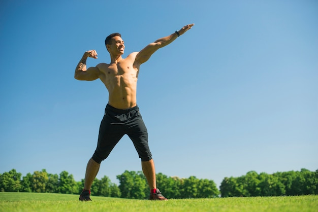 Athletic man practicing sport outdoor