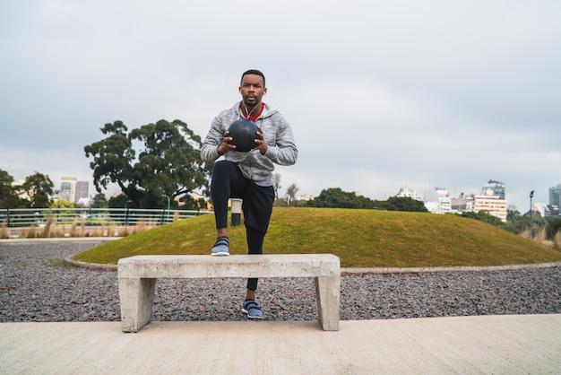 Athletic man training with medicine ball