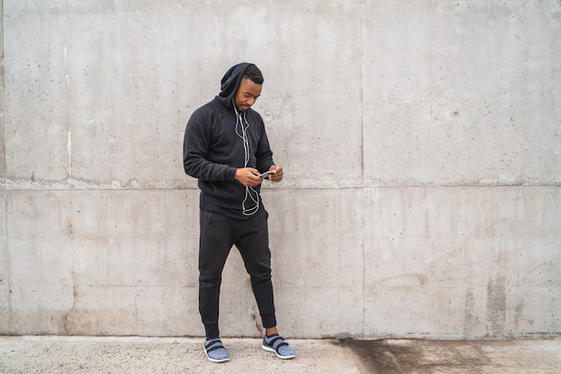 Athletic man using his phone.