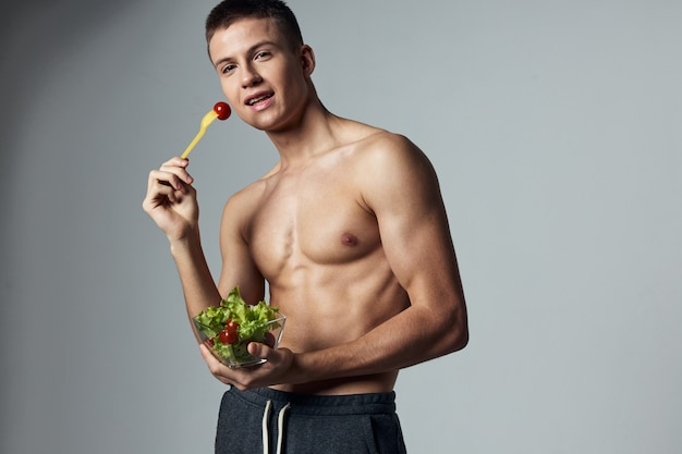 ポンプアップ腹筋健康食品レタスの葉のトレーニングと運動選手