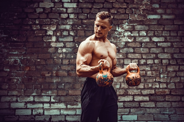 Athletic man working out with a kettlebell. strength and motivation