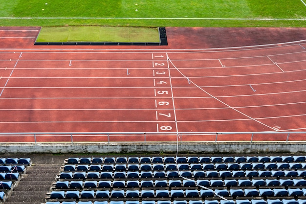 Athletic stadium without spectators during a football match at the time of the coronavirus