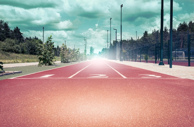 Athletic track with three positions, toned with a retro vintage filter. concept for business, motivation, start.