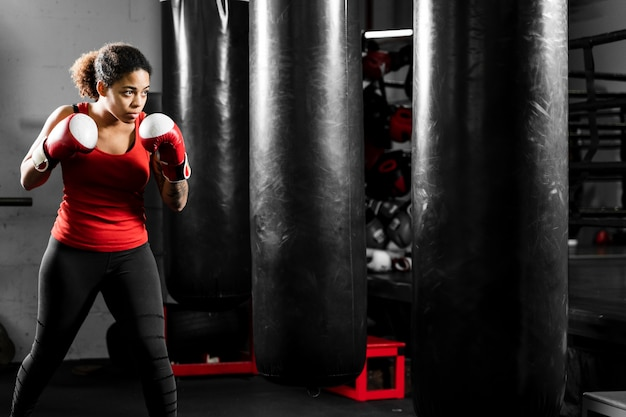 Athletic woman boxing at a training center