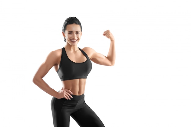 Athletic woman demonstrating strong muscles.