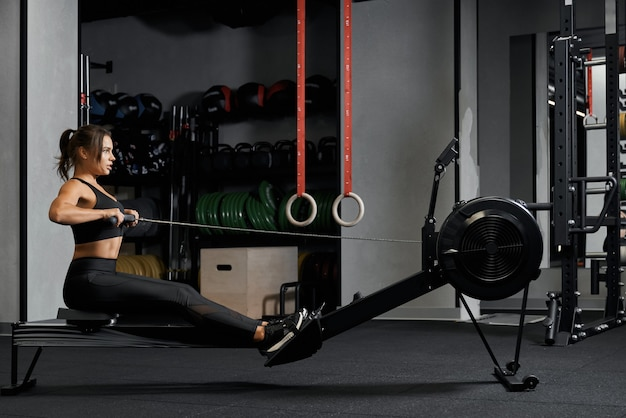 Athletic woman doing exercises in her pectoral muscle