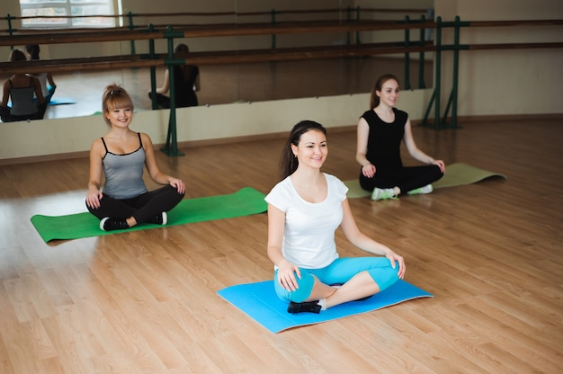 Athletic woman doing relaxation exercises in gym class.