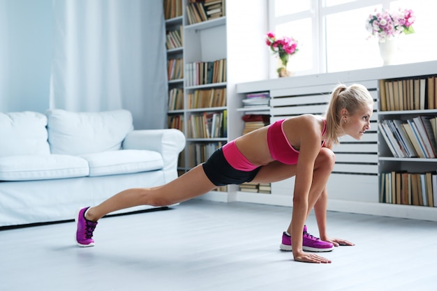 Athletic woman exercising at home, workout