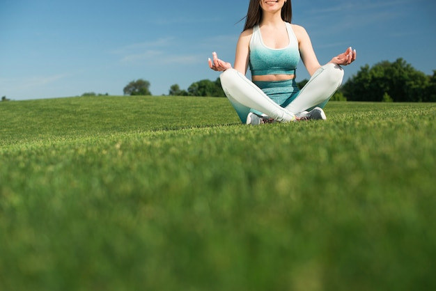 Athletic woman practicing yoga outdoor