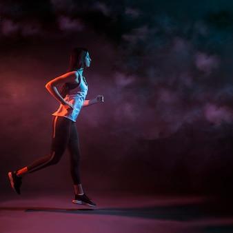 Athletic woman running in studio