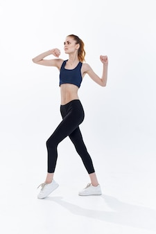 Athletic woman slim figure gym workout energy lifestyle. high quality photo