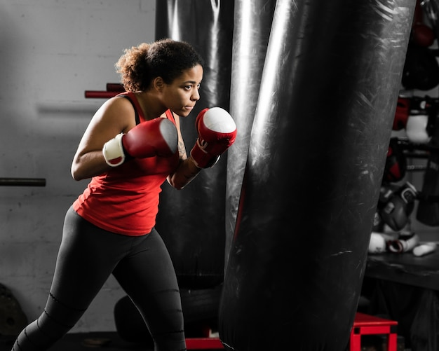 Athletic woman training for boxing