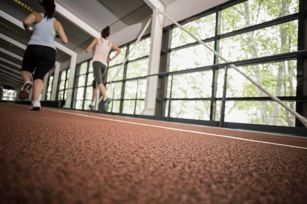 Athletic women running on running track