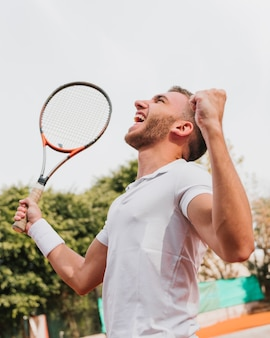 Athletic young boy winning a tennis game