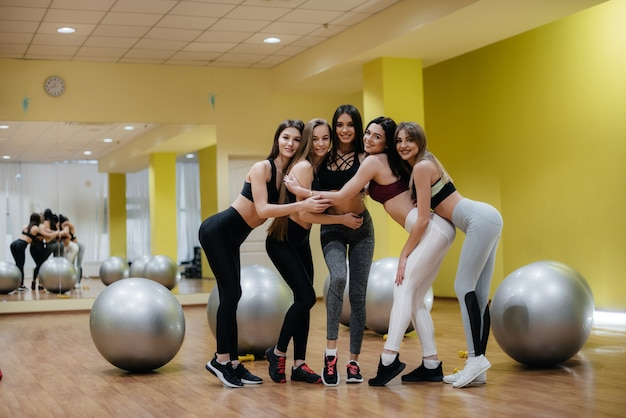Athletic young girls are engaged in fitness and aerobics in a group class. fitness, healthy lifestyle