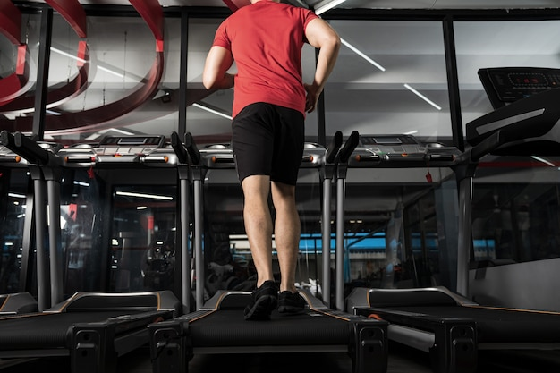 Athletic young man running in gym