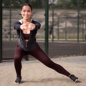 Athletic young woman training outdoors