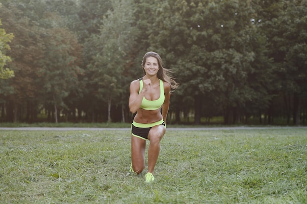 Athletic young woman working out outdoors