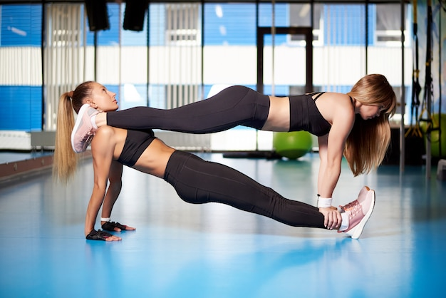 Athletic young women a training in the gym.