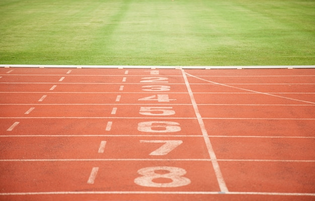 Athletics track lane numbers and grass