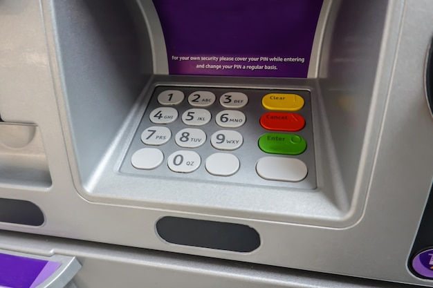 Atm machine closeup at button number code to withdraw transfer money finance