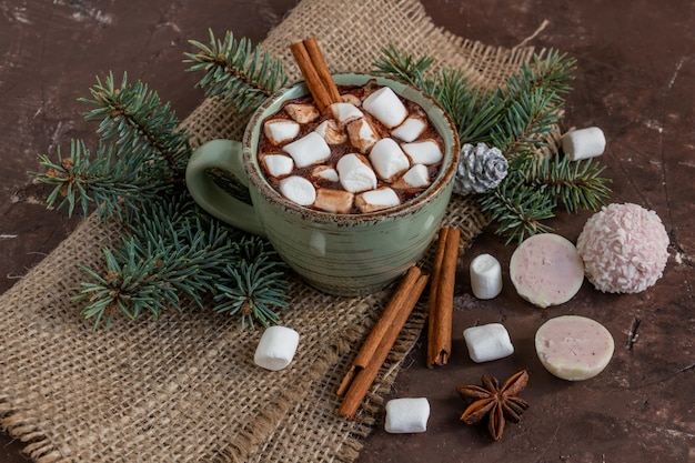 Atmospheric christmas composition, a cup of cocoa with marshmallows, gingerbread cookies, sweets, cinnamon