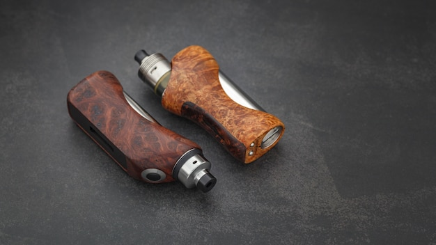 Atomizer with stabilized natural wood regulated box mods