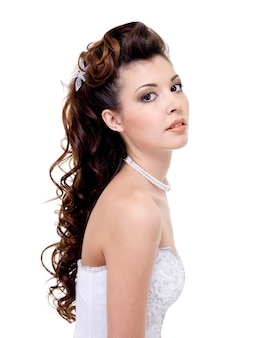 Atractive brunette woman with beauty wedding hairstyle - isolated on white