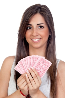 Atractive girl playing cards isolated on white background