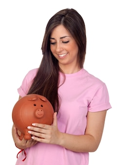 Atractive girl with a big piggy-bank isolated on white background