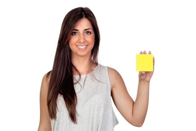 Atractive girl with a yellow post-it isolated on white background