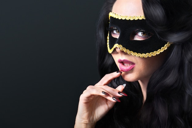 Atractive young woman with venice mask