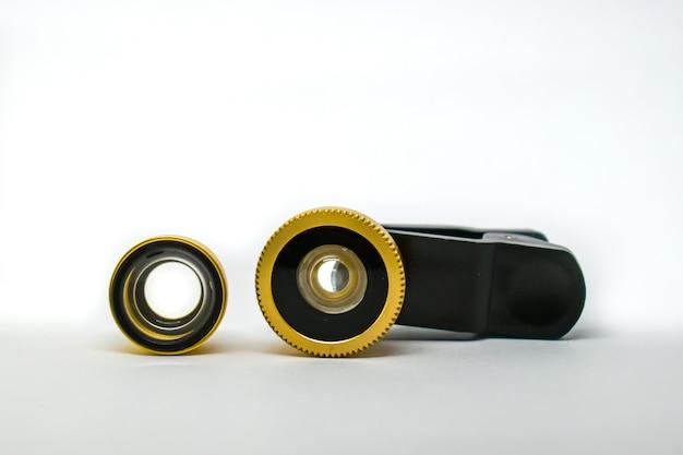 電話カメラへのレンズの取り付け:広角およびマクロ撮影。外部レンズ、携帯電話クリップ